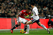 Luis Antonio Valencia of Manchester United (L) in action with Son Heung-min of Tottenham Hotspur. Premier league match, Tottenham Hotspur v Manchester Utd at Wembley Stadium in London on Wednesday 31st January 2018.<br /> pic by Steffan Bowen, Andrew Orchard sports photography.