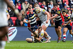 Mitch Eadie of Bristol Rugby is tackled by Chris Cook of Bath Rugby - Rogan Thomson/JMP - 26/02/2017 - RUGBY UNION - Ashton Gate Stadium - Bristol, England - Bristol Rugby v Bath - Aviva Premiership.