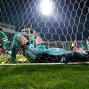 Bursaspor's Ferhat Kiraz (L) scores during their Turkish soccer super league match Bursaspor between Besiktas at Ataturk Stadium in Bursa Turkey on Monday, 08 April 2013. Photo by Aykut AKICI/TURKPIX