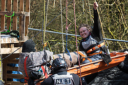 Denham, UK. 22nd March, 2021. Bailiffs from the National Eviction Team (NET) remove two anti-HS2 activists who are locked together from a makeshift tower in Denham Country Park where they had been seeking to delay electricity pylon relocation works by Babcock in connection with the high-speed rail project.
