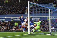 Everton Goalkeeper Tim Howard makes a save from close range to deny Connor Wickham of Crystal Palace. Barclays Premier league match, Everton v Crystal Palace at Goodison Park in Liverpool, Merseyside on Monday 7th December 2015.<br /> pic by Chris Stading, Andrew Orchard sports photography.