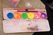 Face painters box of paints and brushes. Dragon Festival Lake Phalen Park St Paul Minnesota USA