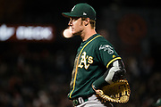 Oakland Athletics first baseman Mark Canha (20) watches gameplay against the San Francisco Giants at AT&T Park in San Francisco, California, on March 26, 2018. (Stan Olszewski/Special to S.F. Examiner)