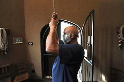"""South Africa - Cape Town - 7 May 2020 - Eddie Esau waits for the Noon Gun to go off over Cape Town at exactly 12 o'clock, before ringing the cathedral bells at the St George's Cathedral. He does this every day. He is the verger at the historic church. A strange silence has descended over places of worship throughout the country and many parts of the world in the midst of the deadliest pandemic since the Spanish Flu of 1918. Eddie lives on the cathedral grounds. He says it has now become a lonely place. Churches have had to close their doors, with national lockdown level 4 still prohibiting gatherings and ordering people to adhere to physical distancing. Dean Michael Weeder is streaming sermons to his congregation from the Deanery during these challenging times. He said """"Too often we become reliant on the priest or pastor, but now the believers has to dig within themselves. This crisis compels us confront ourselves."""" Picture: Armand Hough/African News Agency(ANA)"""