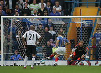 Photo: Lee Earle.<br /> Portsmouth v Bolton Wanderers. The FA Barclays Premiership. 18/08/2007.Matthew Taylor beats Bolton keeper Jussi Jaaskelainen from the spot to score Portsmouth's third goal.