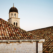 """Rooftops and a bell tower at sunset in the old city of Dubrovnik, Croatia. <br /> <br /> Dubrovnik serves as the official setting of """"King's Landing"""" from the popular TV show """"Game of Thrones"""".<br /> <br /> LICENSING: This is a Royalty Free (RF) image which can be licensed through SpacesImages. Click on the link below:<br /> <br /> http://tinyurl.com/cgsydqh"""