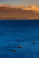 Surfers at Point Castillo, near West Beach, Santa Barbara, California USA.