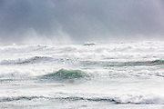 Waves breaking on the sea at Grindavík in south west Iceland.