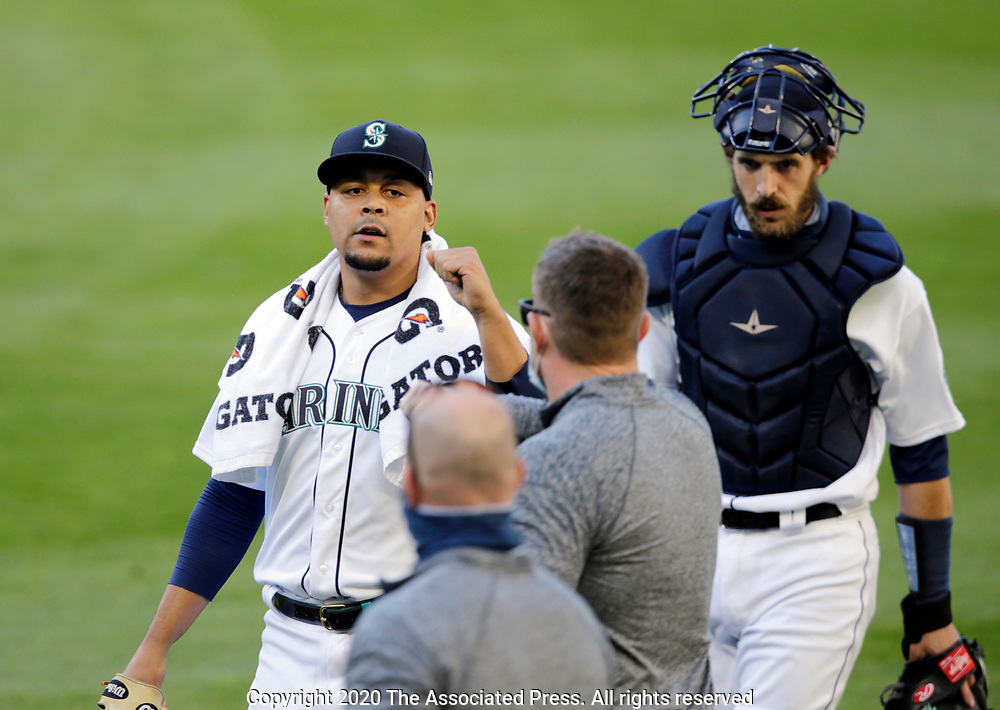 Seattle Mariners pitcher Justus Sheffield and catcher Austin Nola walk to the dugout prior to a baseball game against the Texas Rangers, Saturday, Aug. 22, 2020, in Seattle. (AP Photo/John Froschauer)