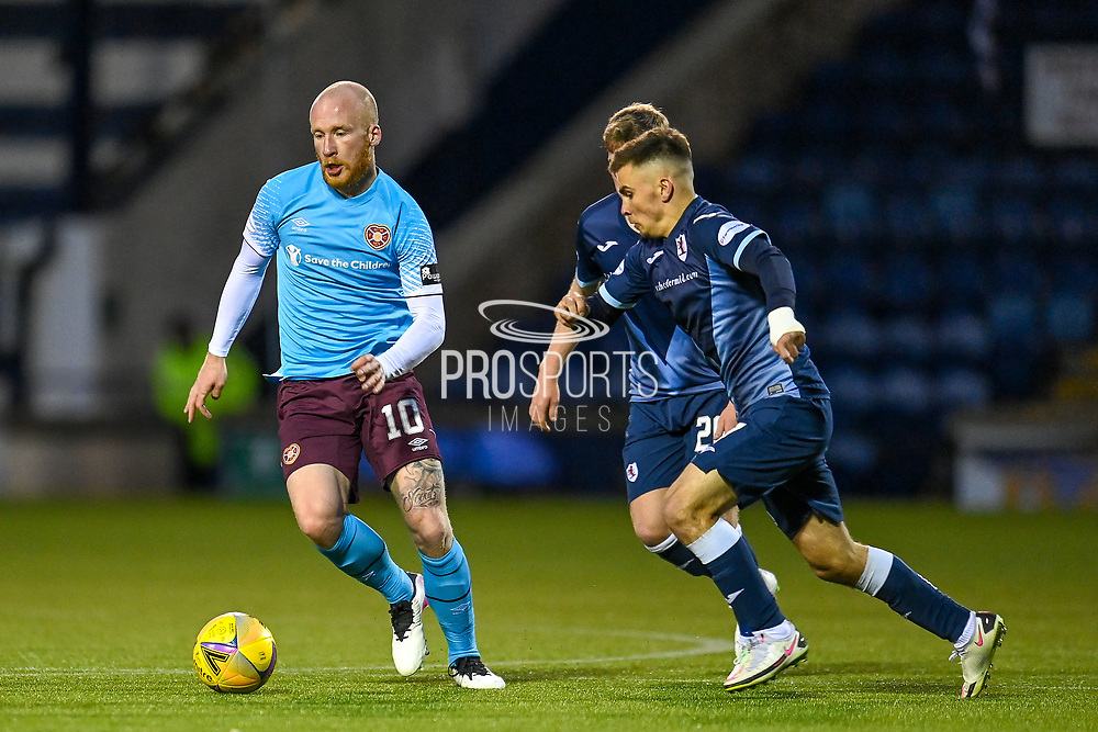 Liam Boyce (#10) of Heart of Midlothian FC runs past Danny Armstrong (#7) of Raith Rovers FC during the SPFL Championship match between Raith Rovers and Heart of Midlothian at Stark's Park, Kirkcaldy, Scotland on 30 April 2021.