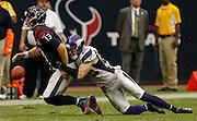 Dec 23, 2012; Houston, TX, USA; Minnesota Vikings free safety Harrison Smith (22) forces a fumble from Houston Texans quarterback T.J. Yates (13) during the fourth quarter at Reliant Stadium. The Vikings won 23-6. Mandatory Credit: Thomas Campbell-USA TODAY Sports