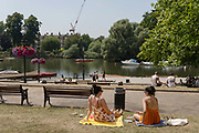 People gather at Richmond riverside as record temperatures soar across England on the 25th July 2019 in Richmond in the United Kingdom. The Met Office has estimated that parts of England could reach a record-breaking 39C this afternoon.
