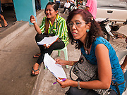 03 JULY 2011 - BANGKOK, THAILAND:   Election monitors from the political parties watch for voting irregularities in Bangkok, Thailand, Sunday July 3. More than 47,000,000 Thais were registered to vote in Sunday's election, which had turned into a referendum on the current government, led, by the Thai Democrats and the oppositionPheu Thai party. Pheu Thai is the latest political incarnation of ousted Thai Prime Minister Thaksin Shinawatra. PT is led by his youngest sister, Yingluck Shinawatra, who is the party's candidate for Prime Minister. Exit polling by three Thai polling firms showed Pheu Thai winning a landslide election.   PHOTO BY JACK KURTZ