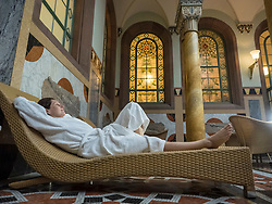 Woman relaxing in heath spa of Palais-Thermal of Bad Wildbad, Baden-Württemberg, Germany