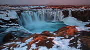 Sunrise at Goðafoss Waterfall, northern Iceland, in winter
