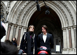 February 5, 2018 - London, London, United Kingdom - Lauri Love at the High Court. Alleged British computer hacker Lauri Love with partner Sylvia Mann arrives at the Royal Courts of Justice in the Strand, central London. Love is appealing the decision of his extradition to the United States, where he is wanted on three warrants from the US districts of New York, Eastern District of Virginia and New Jersey. Love is accused of hacking into US government agencies, including the US Federal Reserve, NASA and the US Army. (Credit Image: © Andrew Parsons/i-Images via ZUMA Press)