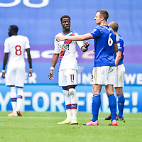 LEICESTER, ENGLAND - JULY 04: Wilfried Zaha of Crystal Palace argues with Jonny Evans of Leicester City during the Premier League match between Leicester City and Crystal Palace at The King Power Stadium on July 4, 2020 in Leicester, United Kingdom. Football Stadiums around Europe remain empty due to the Coronavirus Pandemic as Government social distancing laws prohibit fans inside venues resulting in all fixtures being played behind closed doors. (Photo by MB Media)