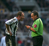 Photo: Andrew Unwin.<br />Newcastle United v Bolton Wanderers. The Barclays Premiership. 04/03/2006.<br />Newcastle's captain, Alan Shearer (L), argues with the referee, Alan Wiley (R).
