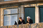 two old ladies talking cais da ribeira porto portugal