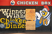Closed down shop front of the Chicken Box take away food restaurant on 18th May 2021 in Birmingham, United Kingdom. The shop, which is currently boarded up has a mural with the popular phrase Winner winner chicken dinner painted outside.