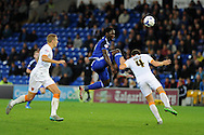 Kenwyne Jones of Cardiff city  is bravely stopped by the head of Hull city's Alex Bruce (4).  Skybet football league championship match, Cardiff city v Hull city at the Cardiff city stadium in Cardiff, South Wales on Tuesday 15th Sept 2015.<br /> pic by Andrew Orchard, Andrew Orchard sports photography.