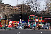 Queue of red buses at Elephant and Castle as the national coronavirus lockdown three continues on 5th March 2021 in London, United Kingdom. Public transport use is still low amongst the public, with all transport for London services aiming to limit numbers. With the roadmap for coming out of the lockdown has been laid out, this nationwide lockdown continues to advise all citizens to follow the message to stay at home, protect the NHS and save lives, and the streets of the capital are quiet and empty of normal numbers of people.