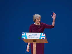 Prime Minister Theresa May greets the audience after the end of her main speech to delegates in the final day of the Conservative party conference at the International Convention Centre, ICC, Birmingham. Wednesday October 5, 2016. Photo credit should read: Isabel Infantes / EMPICS Entertainment.