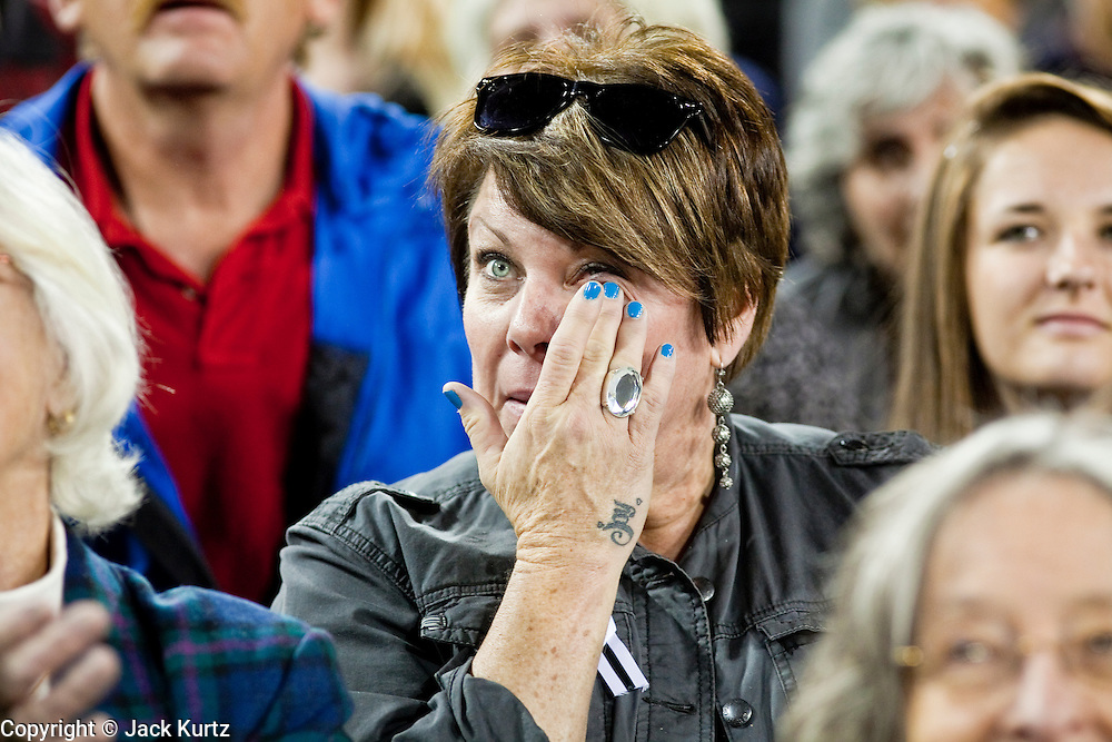 obamatucson 12 JANUARY 2011 - TUCSON, AZ: A woman in the University of Arizona stadium wipes away tears Wednesday when it was used for overflow seating during the Together We Thrive Tucson & America event on University of Arizona campus. Tens of thousands of people filed into the stadium to hear President Obama speak. The service is for the victims of Saturday's mass shooting at a Safeway in Tucson.        ARIZONA REPUBLIC PHOTO BY JACK KURTZ..Gabrielle Giffords shooting, mass shooting,