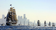 The Tall Ship Europa, left, the largest of the Tall Ships in the parade, follows other ships in a sailpast in Elliott Bay, August 15, 2002. (Greg Gilbert / The Seattle Times)