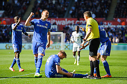 Andre Schurrle (GER) of Chelsea holds his leg after being fouled by Chico (ESP) of Swansea and John Terry (ENG) of Chelsea appeals to the referee - Photo mandatory by-line: Rogan Thomson/JMP - 07966 386802 - 13/04/2014 - SPORT - FOOTBALL - Liberty Stadium, Swansea -  Swansea City v Chelsea FC - Barclays Premier League.