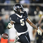 UCF Knights wide receiver Dredrick Snelson (5) drops the football after scoring a touchdown during a NCAA football game between the University of South Florida Bulls and the UCF Knights at Spectrum Stadium on Friday, November 24, 2017 in Orlando, Florida. (Alex Menendez via AP)