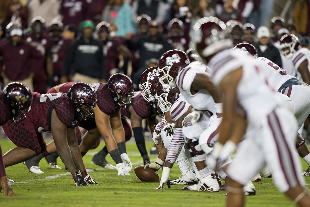 The Mississippi State offensive line prepares for the Texas A&M defense during the second quarter of an NCAA college football game on Saturday, Oct. 28, 2017, in College Station, Texas. (AP Photo/Sam Craft)