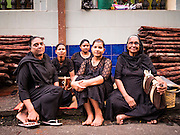 20 OCTOBER 2015 - YANGON, MYANMAR: Shia Muslim women wait for firewalking to start at Punja Mosque in Yangon. Ashura commemorates the death of Hussein ibn Ali, the grandson of the Prophet Muhammed, in the 7th century. Hussein ibn Ali is considered by Shia Muslims to be the third imam and the rightful successor of Muhammed. He was killed at the Battle of Karbala in 610 CE on the 10th day of Muharram, the first month of the Islamic calendar. According to Myanmar government statistics, only about 4% of the population is Muslim. Many Muslims have fled Myanmar in recent years because of violence directed against Burmese Muslims by Buddhist nationalists.    PHOTO BY JACK KURTZ