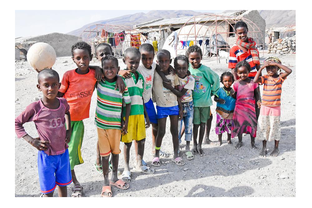Afar children stop their football match for a photo in the Asaita Refugee Camp, Afar, Ethiopia 2016