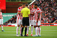 Ibrahim Afellay of Stoke City (c) is spoken to and then receives a red card from referee Michael Oliver. Barclays Premier League match, Stoke city v West Bromwich Albion at the Britannia stadium in Stoke on Trent, Staffs on Saturday 29th August 2015.<br /> pic by Chris Stading, Andrew Orchard sports photography.