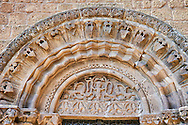 The left portal with geometric Norman-Sicilain elements in the archivolts and relief sculpture of mythical creatures in the lunette, Basilica Church of Santa Maria Maggiore, Tuscania .<br /> <br /> Visit our ITALY PHOTO COLLECTION for more   photos of Italy to download or buy as prints https://funkystock.photoshelter.com/gallery-collection/2b-Pictures-Images-of-Italy-Photos-of-Italian-Historic-Landmark-Sites/C0000qxA2zGFjd_k .<br /> <br /> Visit our MEDIEVAL PHOTO COLLECTIONS for more   photos  to download or buy as prints https://funkystock.photoshelter.com/gallery-collection/Medieval-Middle-Ages-Historic-Places-Arcaeological-Sites-Pictures-Images-of/C0000B5ZA54_WD0s