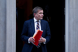 © Licensed to London News Pictures. 16/10/2012. LONDON, UK. David Jones, the Welsh Secretary is seen leaving number 10 Downing Street after today's meeting of David Cameron's cabinet in London today (16/10/12). Photo credit: Matt Cetti-Roberts/LNP