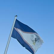 American and American Samoa flags fly proudly; Tutuila Island, American Samoa.