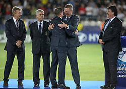 President of the German Football Association Reinhard Grindel (centre right) celebrates with Germany under 21 manager Stefan Kuntz (centre left) before the trophy presentation