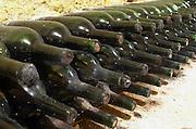 Bottles aging in the cellar. Clos Saint Julien, Saint Emilion, Bordeaux, France