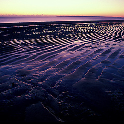 Patterns on a frozen beach at sunrise.  Parker National Wildlife Refuge, Plum Island, Massachusetts