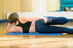 Woman doing aerobics exercises UK