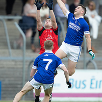 Clondegad's Tony Kelly and Cratloe's Shane Gleeson jump for the ball