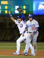 CHICAGO, IL - OCTOBER 22: Javier Baez #9 of the Chicago Cubs celebrates after turning a game ending double play to defeat the Los Angeles Dodgers and send the Chicago Cubs to the World Series in Game 6 of the NLCS at Wrigley Field on Saturday, October 22, 2016 in Chicago, Illinois. (Photo by Ron Vesely/MLB Photos via Getty Images)   *** Local Caption *** Javier Baez