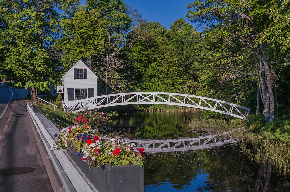 Somesville bridge, arched walkway and reflections with summer flowers, Mount Desert, ME