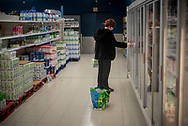Leire, a volunteer member of the Donostia Helping Network, buys some food for Yulissa who is confinated at home. Donostia (Basque Country). April 1, 2020. (Gari Garaialde / Bostok Photo)