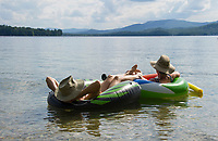 A relaxing afternoon floating in Lake Newfound looking south towards Ragged Mountain.    ©2015 Karen Bobotas Photographer