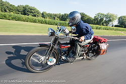 Mechanic and restorer Tanner Whitton of New York riding Mark Hill's 4-cylinder 1915 class-2 Henderson during the Motorcycle Cannonball Race of the Century. Day-4 ride from Bloomington, IN to Cape Girardeau, MO. USA. Wednesday September 14, 2016. Photography ©2016 Michael Lichter.