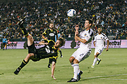 Columbus Crew midfielder/forward Eddie Gaven takes a shot over Los Angeles Galaxy defender Todd Dunivant during the first half of an MLS soccer match Saturday, Sept. 11, 2010, in Carson, Calif. (AP Photo/ Bret Hartman)
