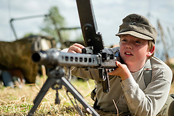 A reenactor portraying a soldier of the German Army (Heer) undergoes weapons training on the (Maschinengewehr 1942)in its Light Machine gun role. He wearing the german army issue undershirt and M43 Field Cap<br /> <br />  17 July 2016<br />  Copyright Paul David Drabble<br />  www.pauldaviddrabble.photoshelter.com